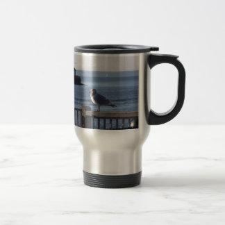 Seagull on the harbor bay travel mug