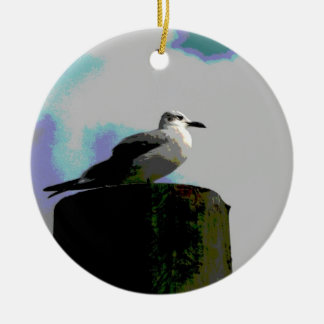 Seagull sitting on a dock posterized photograph christmas tree ornament