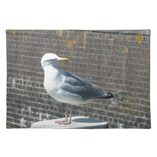 Seagull standing on a pillar at the ocean placemat