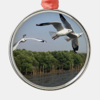 Seagulls at the beach metal ornament