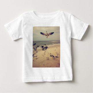 Seagulls flying on the beach shirt