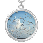 seagulls flying over beach jewelry