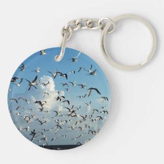 seagulls flying over beach keychain