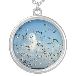 seagulls flying over beach silver plated necklace