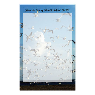 seagulls flying over beach stationery