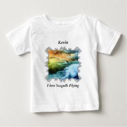 seagulls flying over the open ocean. baby T-Shirt