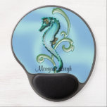 "Seahorse in the Seaweed Gel Mouse Pad<br><div class=""desc"">This pretty design called, Seahorse in the Seaweed, has a sweet whimsical feel. This cool illustration started life as a sketch and was colored in photoshop. The background is a swirl of blues giving it a soft water look. It shows a seahorse in blue, turquoise, and gold with a single...</div>"