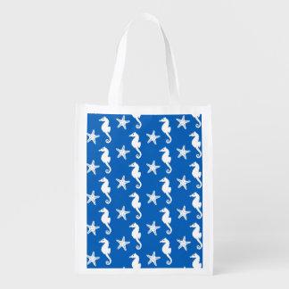 Seahorse & starfish - white on cobalt blue reusable grocery bag