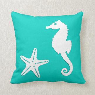 Seahorse & starfish - white on turquoise throw pillow