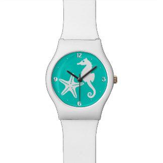 Seahorse & starfish - white on turquoise wristwatches