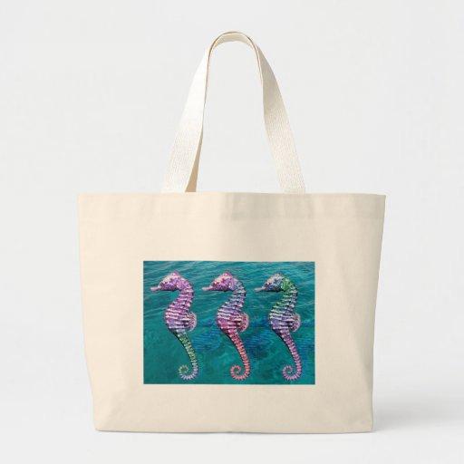 Seahorses on Ocean Background Tote Bags