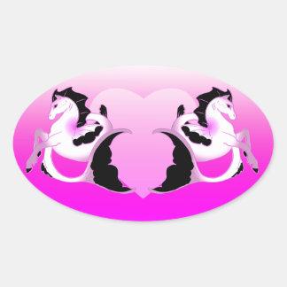 Seahorses rosados de la perla pegatina ovalada