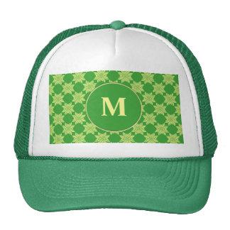 Seamless green leafy pattern trucker hats