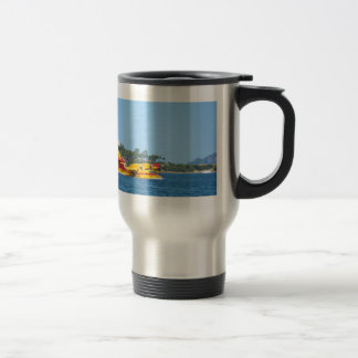 Seaplane taxiing on water. 15 oz stainless steel travel mug