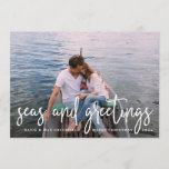 "Seas and Greetings | Nautical Holiday Photo Card<br><div class=""desc"">Send holiday greetings to friends and family in nautical style with these coastal chic holiday photo cards. Design features your favorite photo with ""seas and greetings"" overlaid in white hand sketched lettering. Personalize with your names, custom greeting (shown with ""Merry Christmas"") and the year. Cards reverse to a white nautical...</div>"