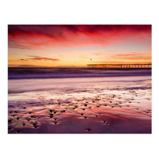Seascape and pier at sunset, CA Postcard
