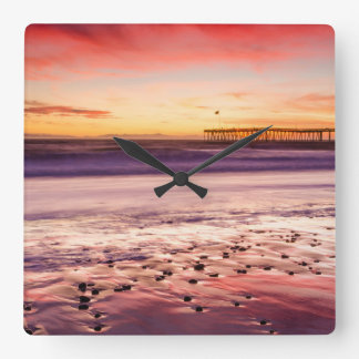 Seascape and pier at sunset, CA Square Wall Clock