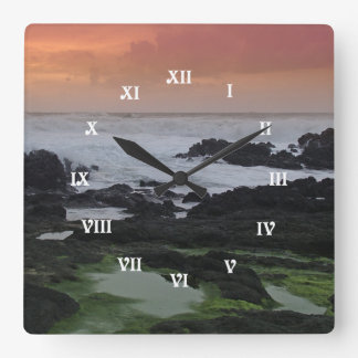 Seascape at sunset square wall clock