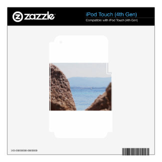Seascape of Tavolara island on blurred rocks foreg Decal For iPod Touch 4G