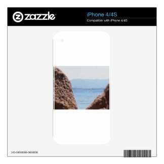 Seascape of Tavolara island on blurred rocks foreg Decal For iPhone 4S