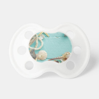 seashell collage on Turquoise background Pacifier