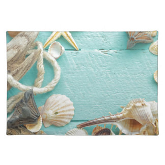 seashell collage on Turquoise background Cloth Placemat