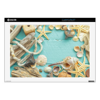"""seashell collage on Turquoise background 17"""" Laptop Decal"""