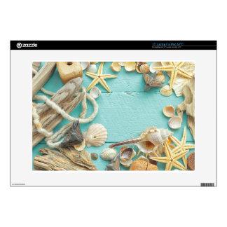 seashell collage on Turquoise background Laptop Skin