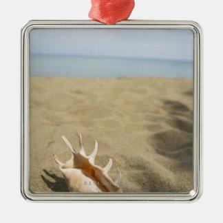 Seashell on sandy beach metal ornament