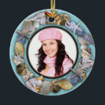"""Seashells, Blue Photo Frame Christmas Ornament<br><div class=""""desc"""">Round, ceramic Christmas beach ornament with a photo template in the center. A tropical themed keepsake to personalize by adding name, holiday and date to the back, which has a sand dollar image. Add a picture using the easy template option. Lots of tropical seashell images are featured all around the...</div>"""