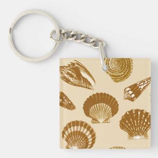 Seashells - Brown on a beige background Keychain