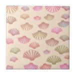 Seashells en la arena azulejo ceramica