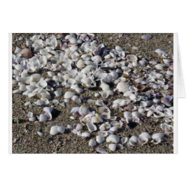 Beach Themed Seashells on sand. Summer beach background Card