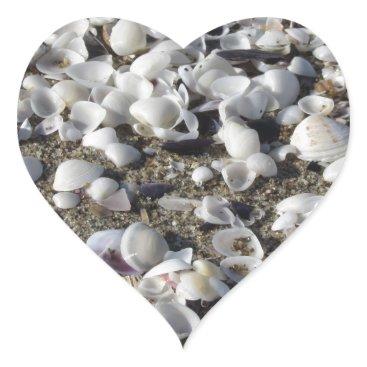 Beach Themed Seashells on sand. Summer beach background Heart Sticker