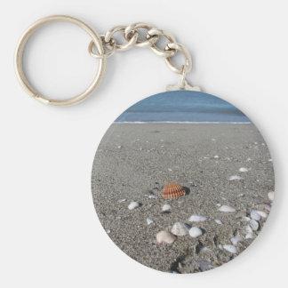 Seashells on sand. Summer beach background Keychain