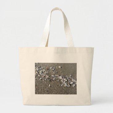 Beach Themed Seashells on sand. Summer beach background Large Tote Bag
