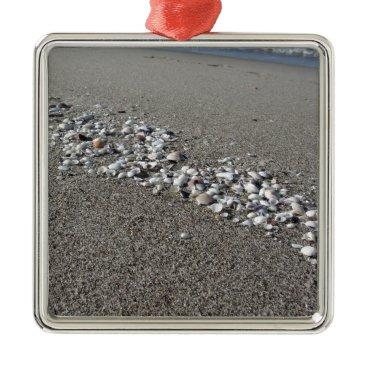 Beach Themed Seashells on sand Summer beach background Top view Metal Ornament