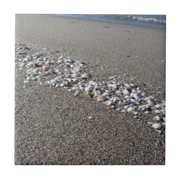 Beach Themed Seashells on sand Summer beach background Top view Tile