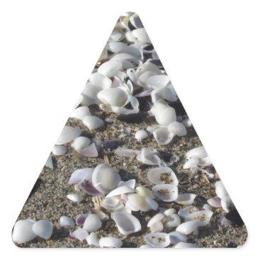 Beach Themed Seashells on sand. Summer beach background Triangle Sticker