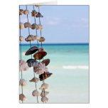 seashells on sea background card
