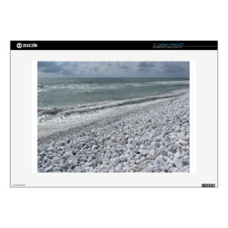 Seashore of a beach in a cloudy day at summer laptop skins