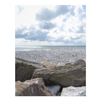 Seashore of a beach in a cloudy day at summer letterhead