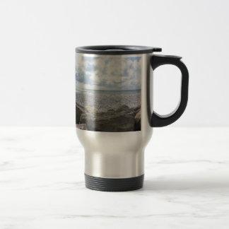 Seashore of a beach in a cloudy day at summer travel mug