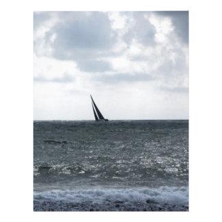 Seashore of beach during regatta at summer letterhead