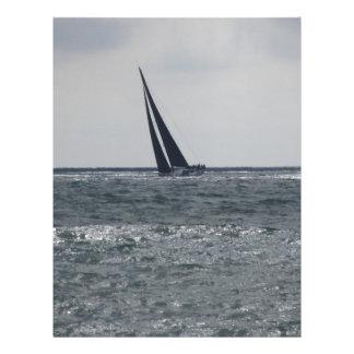 Seashore of beach during regatta letterhead