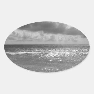 Seashore of Marina di Pisa beach in a cloudy day Oval Sticker