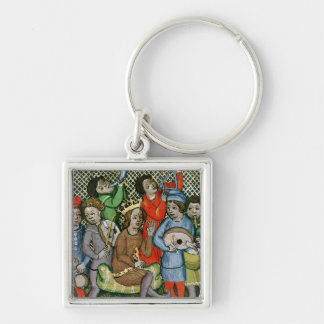 Seated crowned figure surrounded by musicians keychain