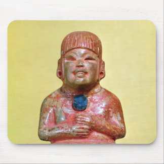 Seated figure, possibly one  earliest mouse pad