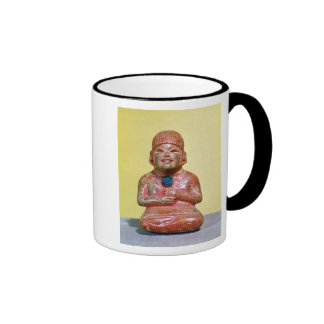 Seated figure, possibly one  earliest coffee mugs