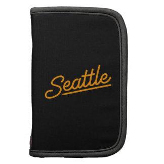 Seattle in orange folio planners